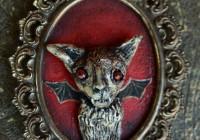 gold Bat in vintage frame frame